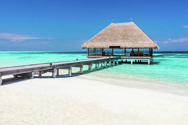 Photograph - Wooden Jetty On Blue Ocean In Maldives. by Michal Bednarek