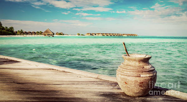Wall Art - Photograph - Wooden Jetty On The Ocean And Maldivian Resort by Michal Bednarek