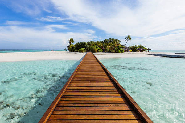 Wall Art - Photograph - Wooden Jetty To A Tropical Island, Maldives by Matteo Colombo