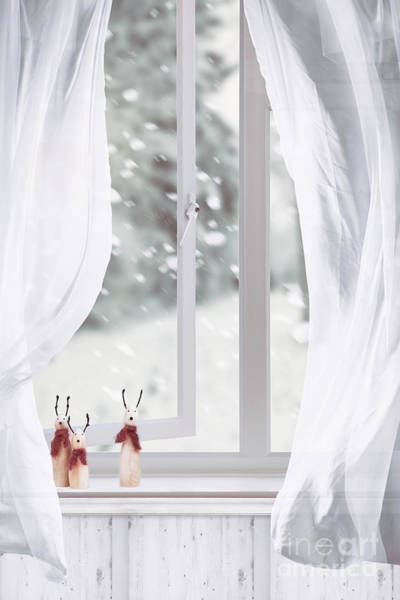 Wall Art - Photograph - Wooden Reindeers Sitting In Window by Amanda Elwell