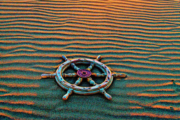 Wall Art - Photograph - Wooden Ships Wheel On Wavey Sand by Garry Gay
