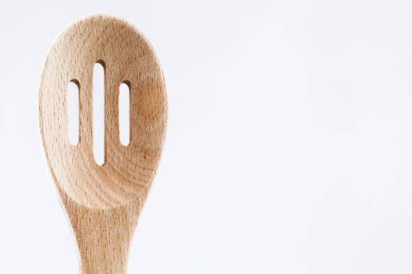 Photograph - Wooden Slotted Spoon by Jeanette Fellows