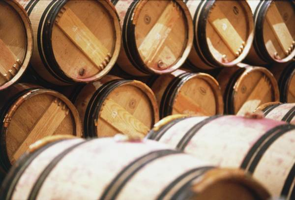 Warehouse Photograph - Wooden Wine Barrels Stored On Top Of by Ian O'leary