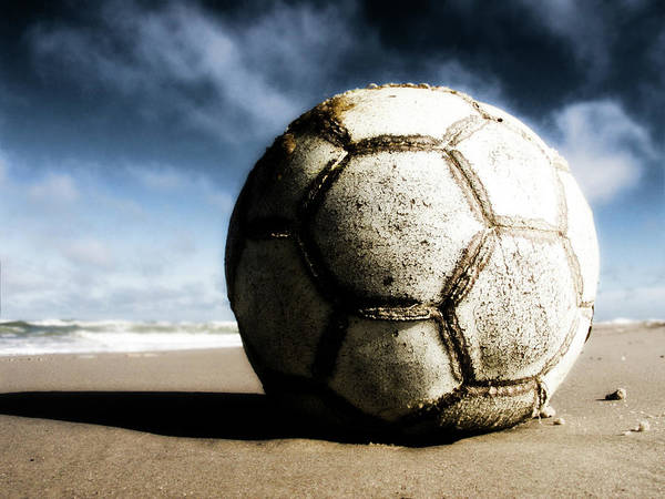 Shadow Photograph - Worn And Old Soccer Ball On Sand by Vithib