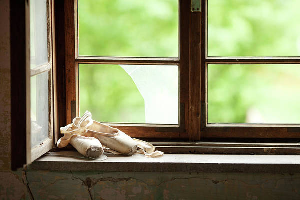 Shoe Photograph - Worn Out  Ballet Shoes Lie On The Old by Miljko