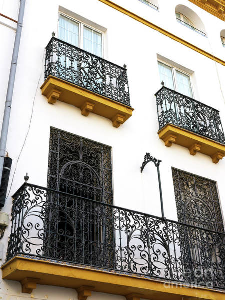 Photograph - Wrought Iron Style In Seville by John Rizzuto
