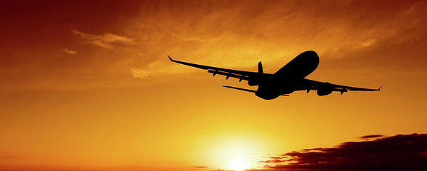 Taking Off Photograph - Xl Jet Airplane Taking Off At Sunset by Sharply done