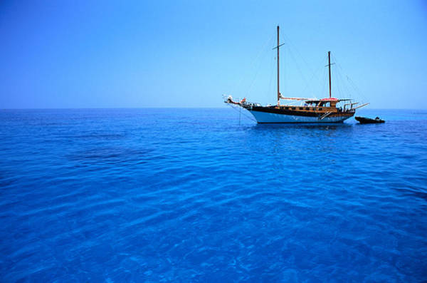 Sardinia Photograph - Yacht Anchored In Waters Of Gulf Of by Dallas Stribley