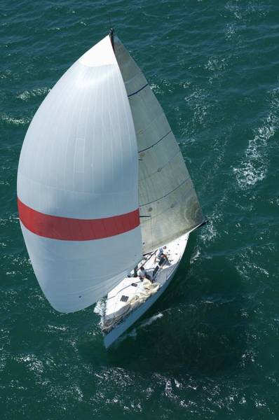 Spinnaker Photograph - Yacht Competes In Team Sailing Event by Moodboard