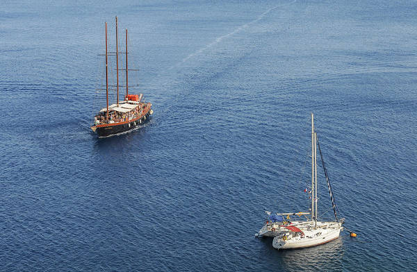 Wall Art - Photograph - Yachts Sailing On A Blue Calm Sea by Michalakis Ppalis