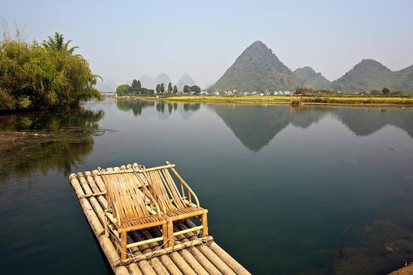 Raft Photograph - Yangshuo, Bamboo Raft On The Yulong by John Seaton Callahan