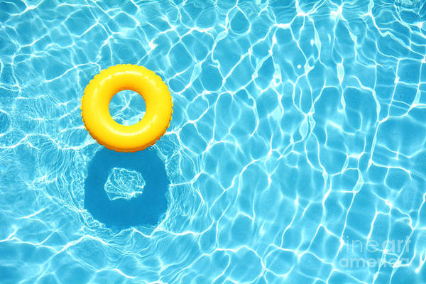 Wall Art - Photograph - Yellow Pool Float, Ring Floating In A by Staciestauffsmith Photos