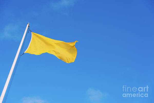 Photograph - Yellow Warning Flag On A Beach Against The Blue Sky Background. by Joaquin Corbalan