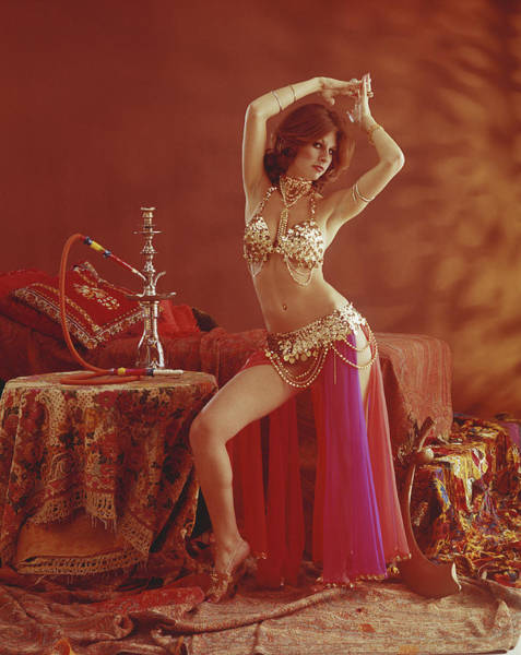 Belly Dancers Photograph - Young Belly Dancer Dancing Beside by Tom Kelley Archive