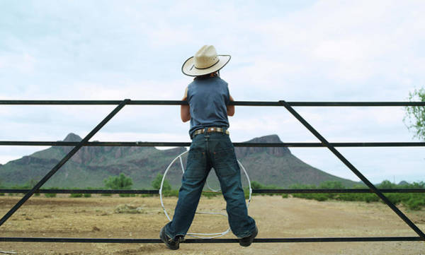 Ranch Photograph - Young Boy 7-8 Standing On Ranch Railing by John Slater