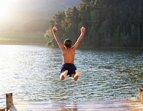Wall Art - Photograph - Young Boy Jumping Into Lake by Monkey Business Images