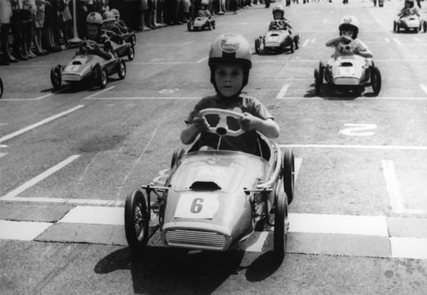 Driving Photograph - Young Boys Driving Racing Pedal Cars by Keystone-france