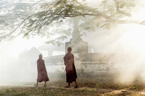 Shaved Head Photograph - Young Buddhist Monks Walking Along Path by Martin Puddy