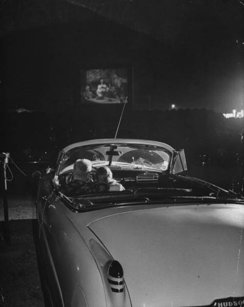 Romance Photograph - Young Couple Cuddling At The Drive In by Francis Miller