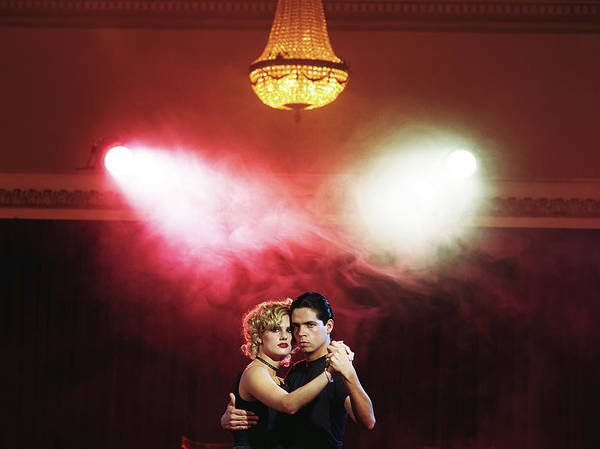 Wall Art - Photograph - Young Couple Dancing Tango Under by Javier Pierini