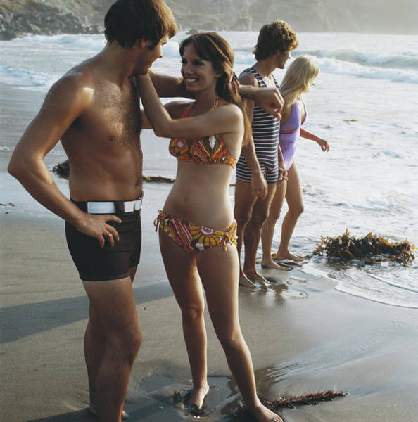 Toothy Smile Photograph - Young Couples Standing On Beach, Smiling by Tom Kelley Archive
