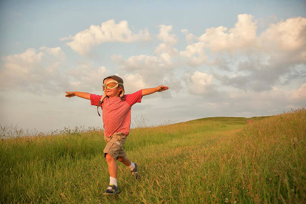 Taking Off Photograph - Young English Boy Imagines Flying On by Richvintage