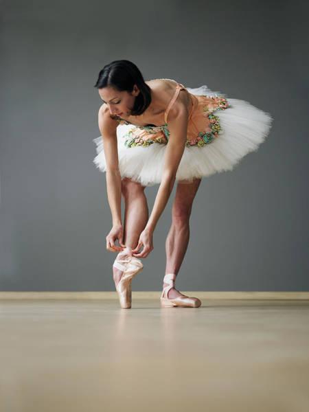 Buns Photograph - Young Female Ballerina Adjusting Ballet by Thomas Barwick