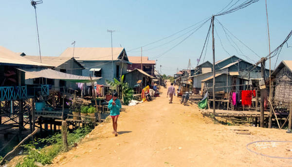 Houses Wall Art - Photograph - Young Girl - Houses On Stilts - Siem Reap, Cambodia by Madeline Ellis