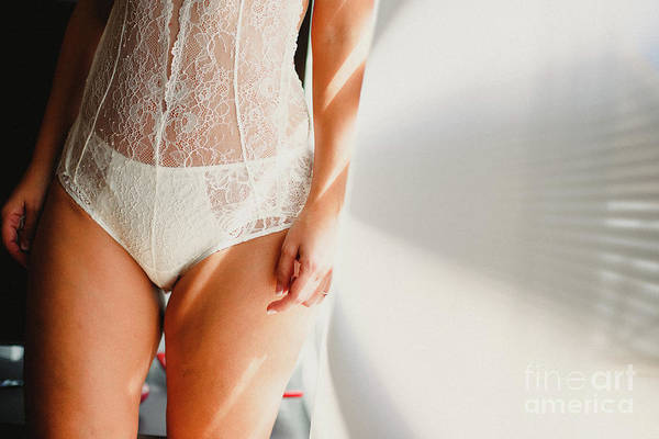 Photograph - Young Girl Wearing White Lingerie Posing With Natural Light, Noface. by Joaquin Corbalan