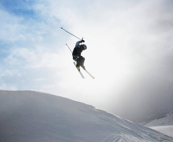 Ski Jumping Photograph - Young Male Skier Mid-air, Rear View by Paul Bradbury