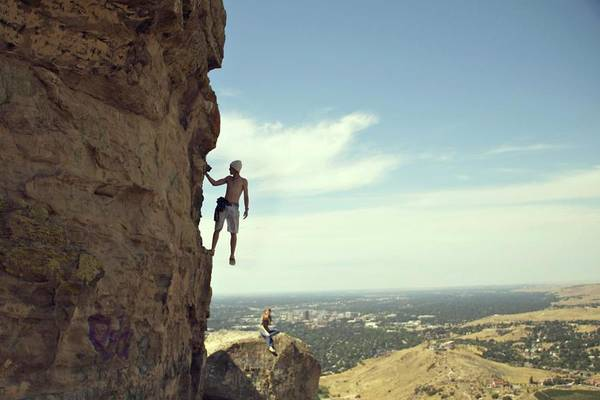 Hanging Rock Photograph - Young Man Climbs While Girl Looks On by Marit Photography