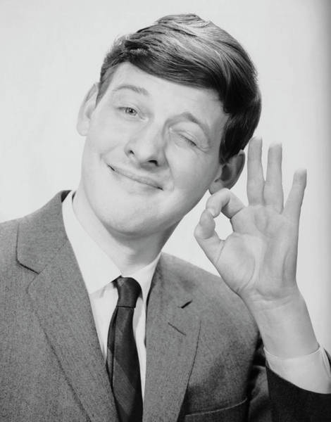 Gesturing Photograph - Young Man Making The O.k. Sign by George Marks
