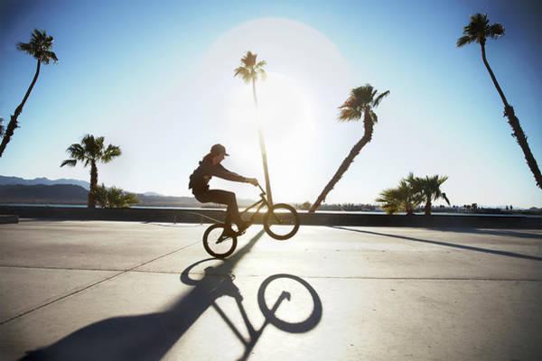 Bmx Photograph - Young Man Performing Trick On Bmx by Karen D'silva