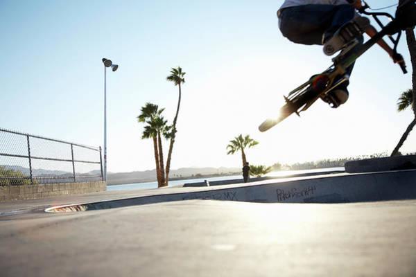 Bmx Photograph - Young Man Performing Trick On Bmx, Low by Karen D'silva