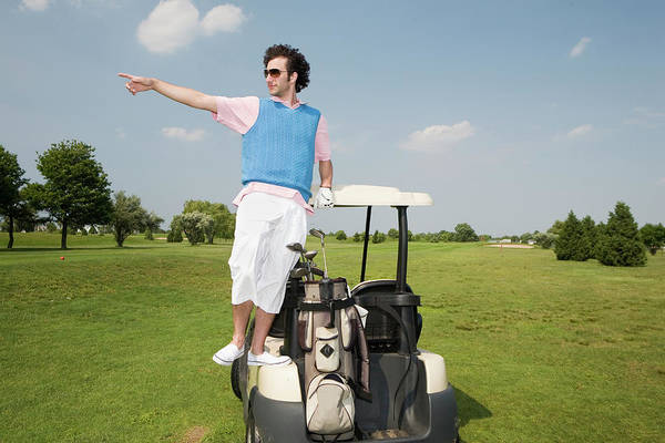 Golf Photograph - Young Man Standing On Golf Cart by Hollenderx2