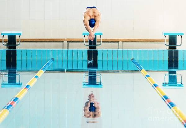 Health Wall Art - Photograph - Young Muscular Swimmer Jumping From by Nejron Photo