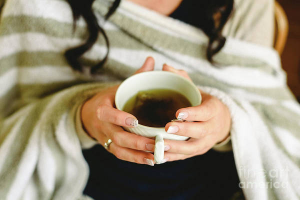 Photograph - Young Woman Having A Tea, Close-up Of The Cup. by Joaquin Corbalan