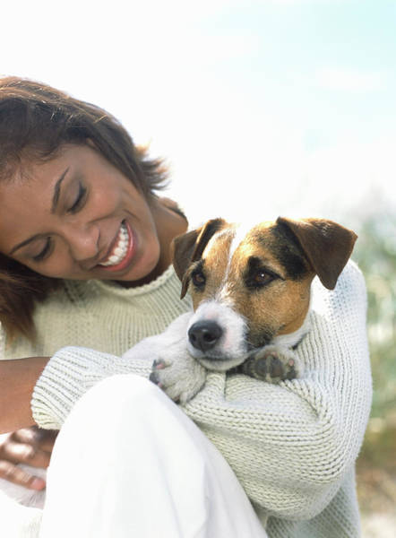 Toothy Smile Photograph - Young Woman Holding Jack Russell by Todd Pearson