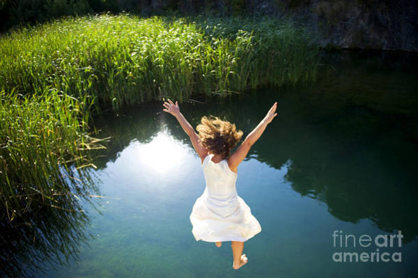Hot Spring Wall Art - Photograph - Young Woman In White Dress Jumping Into by Luna Vandoorne