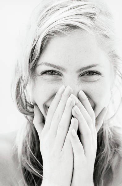 Laughing Photograph - Young Woman Laughing, Hands Over Mouth by Pando Hall