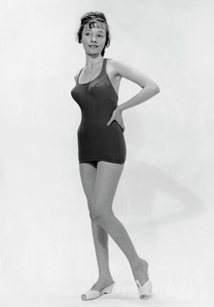 One Piece Swimsuit Photograph - Young Woman Poses In Bathing Suit by George Marks