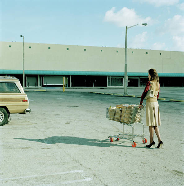 Car Part Photograph - Young Woman Pushing Trolly Full Of by Kelvin Murray