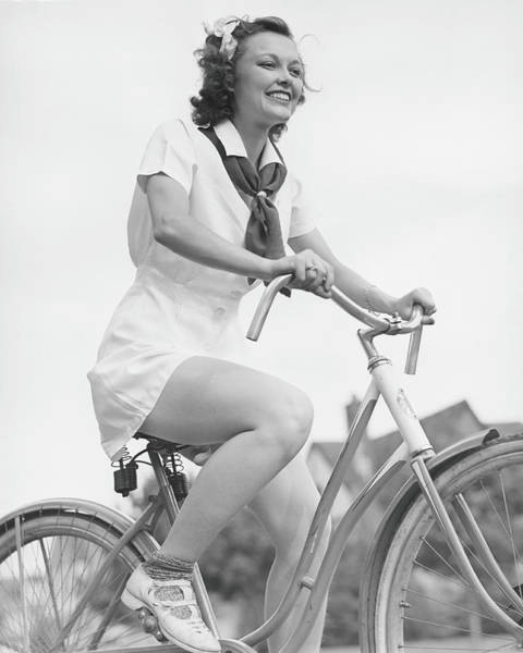 Suburbs Photograph - Young Woman Riding Bicycle, B&w, Low by George Marks