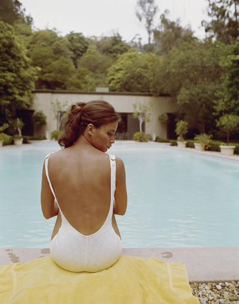 1974 Photograph - Young Woman Sitting At Edge Of Swimming by Tom Kelley Archive