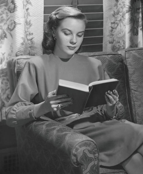 Reading Photograph - Young Woman Sitting On Sofa, Reading by George Marks