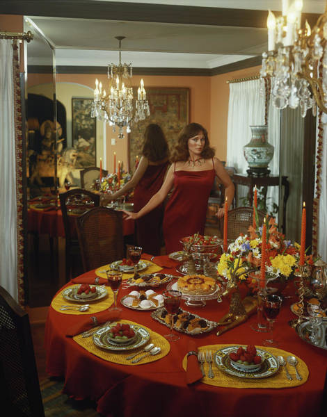 Wall Art - Photograph - Young Woman Standing Beside Dining by Tom Kelley Archive