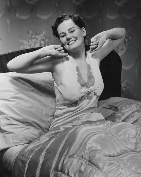Gesturing Photograph - Young Woman Stretching In Bed, B&w by George Marks