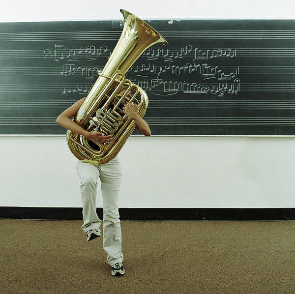 Wall Art - Photograph - Young Woman Struggling To Hold Tuba In by Jonathan Kirn