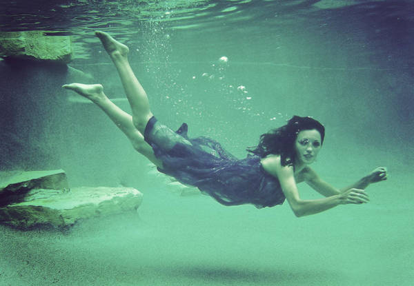 Underwater Camera Photograph - Young Woman Swimming,  Underwater View by Julian Humphries