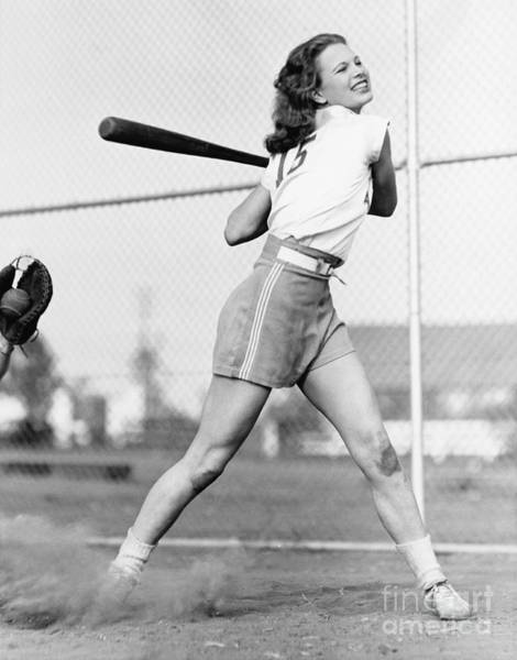 Wall Art - Photograph - Young Woman Swinging A Baseball Bat In by Everett Collection